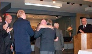 Montreal elders congratulation Lynn Lawrence after her ordination.