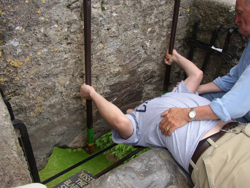Kissing the Blarney Stone (public domain via Wikimedia Commons)