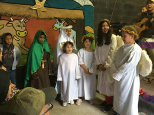 Crossing Borders Kids Dressed Up as Angels at Marta Nativity Scene