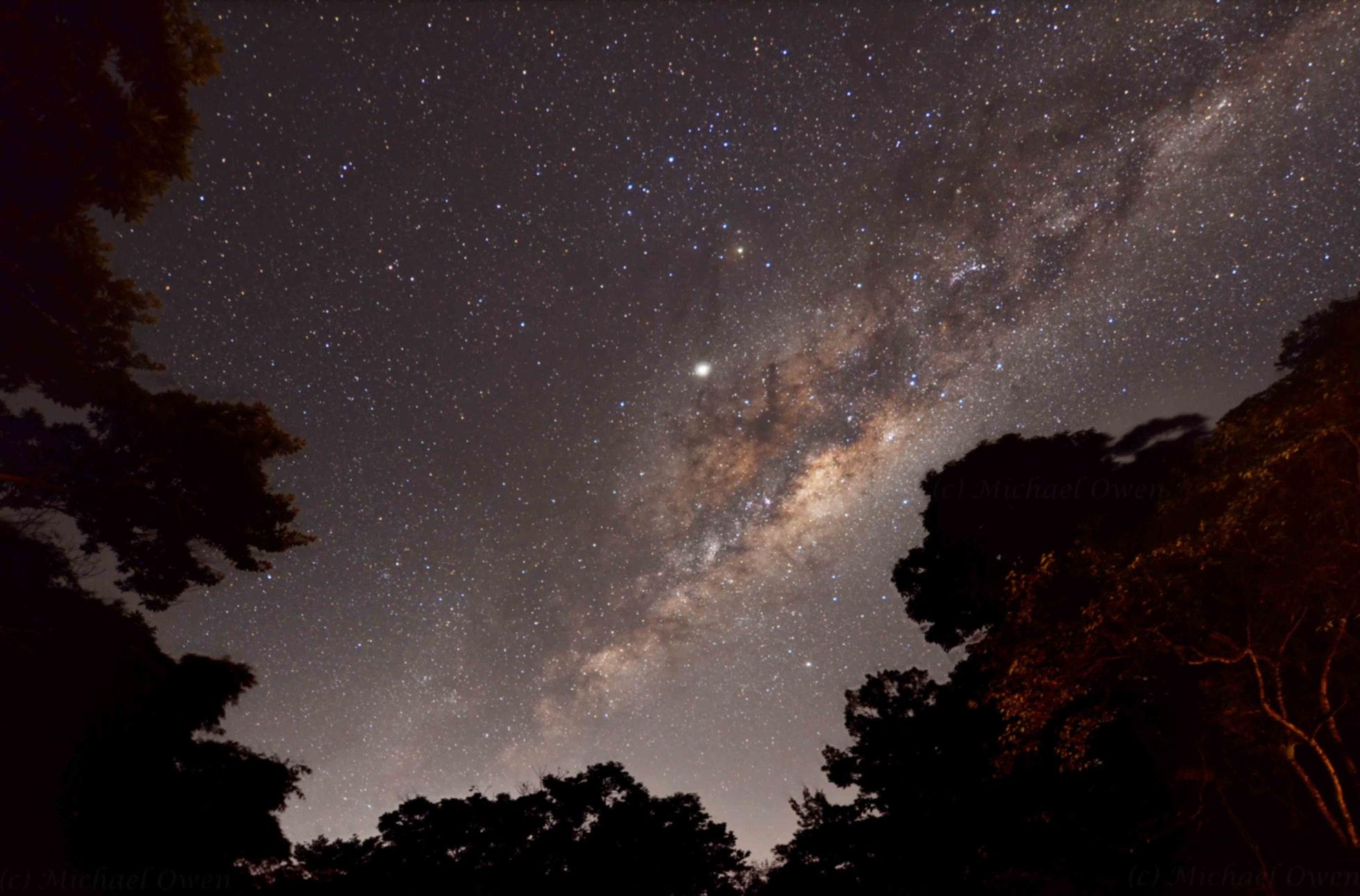 photo of the night sky with stars illuminated