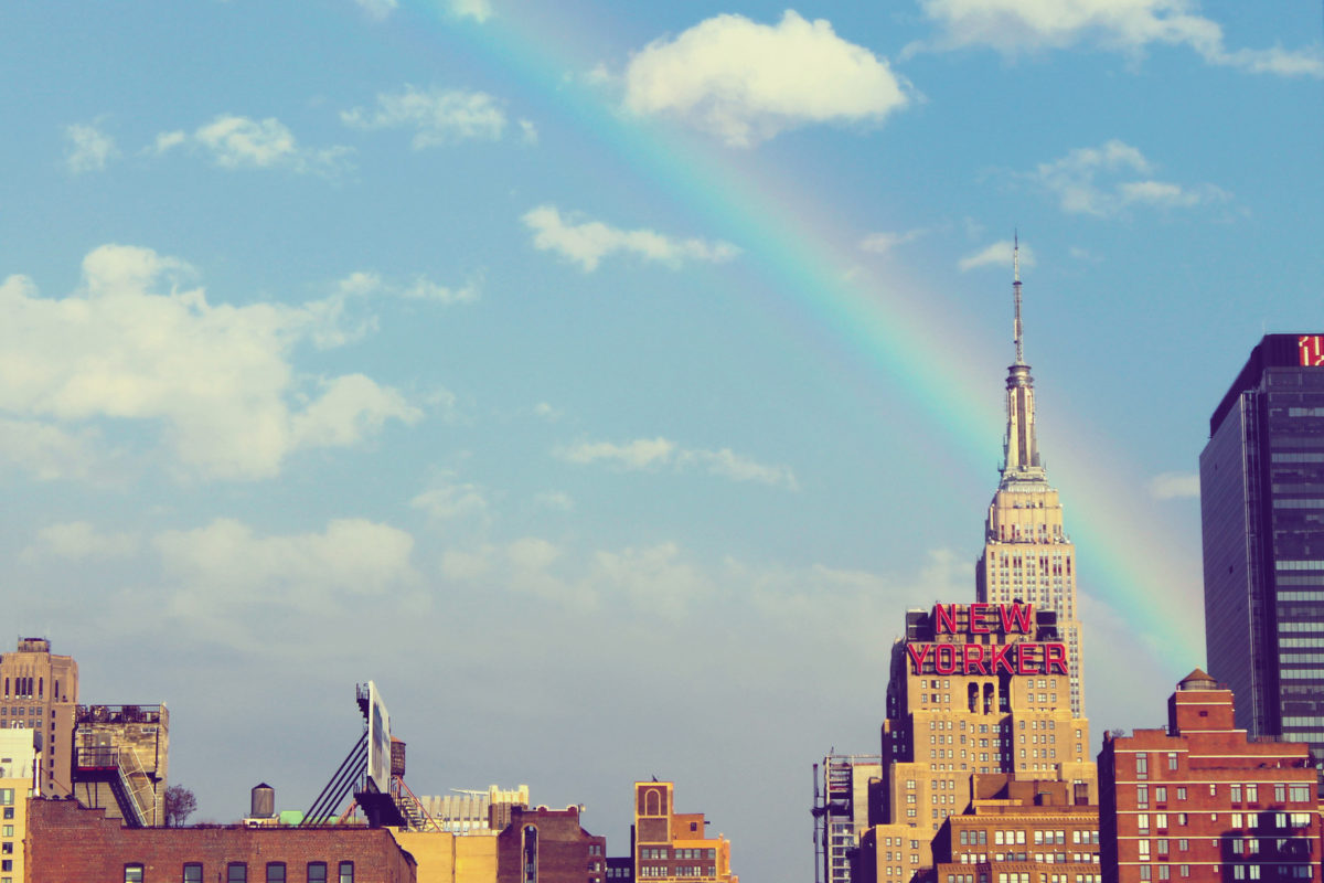 Photo of the New York skyline with a rainbow on the horizon